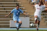 06 September 2009: UNC's Brett King (4) and Evansville's Tom Irvin (13). The University of North Carolina Tar Heels defeated the Evansville University Purple Aces 4-0 at Fetzer Field in Chapel Hill, North Carolina in an NCAA Division I Men's college soccer game.