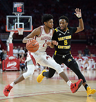 NWA Democrat-Gazette/ANDY SHUPE<br /> Arkansas guard Isaiah Joe (left) drives past Northern Kentucky guard Bryson Langdon Saturday, Nov. 30, 2019, during the first half of play in Bud Walton Arena. Visit nwadg.com/photos to see more photographs from the game.