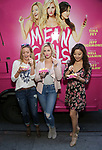 Kate Rockwell, Taylor Louderman and Ashley Park  from 'Mean Girls' cast visit the 'Mean Girls' themed Food Truck in celebration of 'Mean Girls' Box Office Opening Day on Broadway in Times Square on October 3, 2017 in New York City.