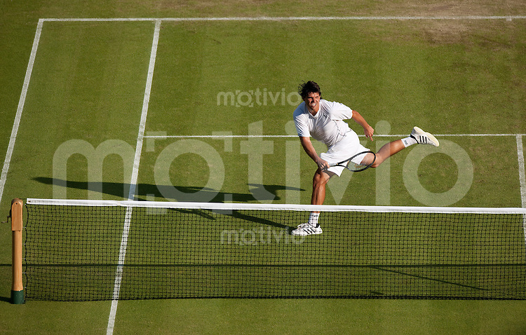 Taylor Dent (USA) plays against Novak Djokovic (SRB) on Centre Court. The Wimbledon Championships 2010 The All England Lawn Tennis & Croquet Club  Day 3 Wednesday 23/06/2010