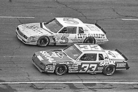 HAMPTON, GA - NOV 3:  Geoff Bodine, #5 Chevrolet and Harry Ganr, #33 Buick, race through a turn during the Atlanta Journal 500 NASCAR Winston Cup race at Atlanta Motor Speedway, November 3, 1985. (Photo by Brian Cleary/www.bcpix.com)