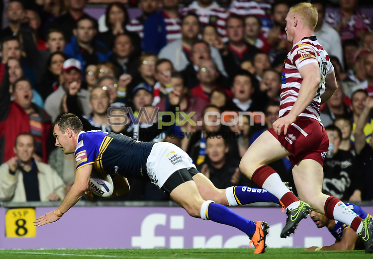 Picture by Alex Broadway/SWpix.com - 10/10/2015 - Rugby League - First Utility Super League Grand Final - Leeds Rhinos v Wigan Warriors - Old Trafford, Manchester, England - Danny McGuire of Leeds Rhinos scores his team's third try.
