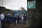 Home supporters heading for the exit at the end of the game between Greenock Morton and Stranraer in a Scottish League One match at Cappielow Park, Greenock. The match was between the top two teams in Scotland's third tier, with Morton winning by two goals to nil. The attendance was 1,921, above average for Morton's games during the 2014-15 season so far.