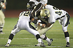 Torrance, CA 11/05/10 - Austin Watters (West # 12), Ryan Sawelson (Peninsula #32) and Haden Gregory (Peninsula #42) in action during the Peninsula vs West varsity football game played at West Torrance high school.