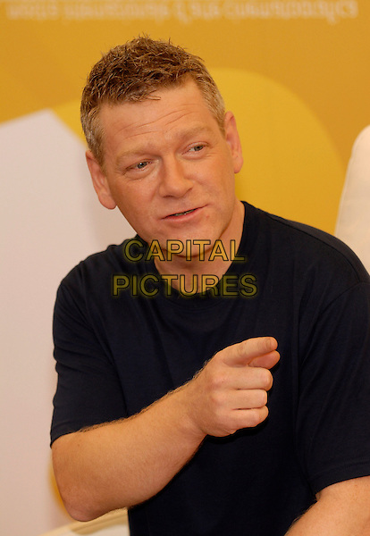 "KENNETH BRANAGH .Photocall of ""The Magic Flute"" at the Lido of Venice during the 63rd Venice International Film Festival, Venice, Italy.September 7th, 2006.Ref: KRA.half length hand pointing blue tee shirt.www.capitalpictures.com.sales@capitalpictures.com.©Persun/Capital Pictures."