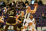 SIOUX FALLS, SD - NOVEMBER 25: Jacey Huinker #23 from the University of Sioux Falls takes the ball to the basket past Abuk Akoi #35 from Southwest Minnesota State University during their game Saturday evening at the Stewart Center in Sioux Falls. (Photo by Dave Eggen/Inertia)