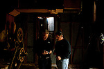 "Ghost hunters and cousins Andy Carter and Chris Carter look at an audio recorder inside of a rumored haunted cotton gin that dates back to the 1830s as they follow-up on an investigation. The ""paranormal investigators"" of Twisted Dixie are Grady Carter, Andy Carter, Chris Carter (all related), and Chris Phillips, seen in Antreville, South Carolina November 4, 2011."