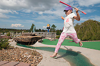 NWA Democrat-Gazette/J.T. WAMPLER Allie Easterling, 8,  leaps a water hazard Monday Sept. 28, 2015 while playing mini golf in Rogers. Easterling was playing with her brother Andrew, 5, and mother Gina Easterling of Pea Ridge, not pictured. The children had the day off of school because of an inservice day at Pea Ridge.