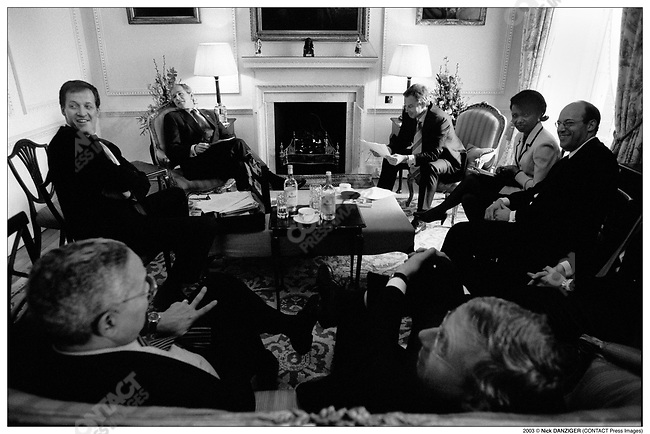 President George W. BUSH and Prime Minister Tony BLAIR hold a joint cabinet meeting. Alastair CAMPBELL, Tony's BLAIR Communication Director (extreme left), National Security Advisor Condoleezza Rice (upper right), Secretary of State for Foreign and Commonwealth Affairs Jack Straw (lower right) and Secretary of State Colin Powell (lower left). Hillsborough Castle, Northern Ireland. April 8, 2003..2003 ©ÊNick DANZIGER (CONTACT PRESS IMAGES)