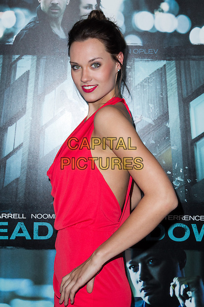 Laura james.The premiere of FilmDistricts's 'Dead Man Down' at ArcLight Hollywood, Hollywood, California, USA..February 26th, 2013.half length red halterneck side dress hands on hips lipstick .CAP/ADM/JS.©John Salangsang/AdMedia/Capital Pictures.