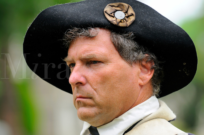 Soldier of the Sixth Connecticut Regiment, Company of Light Infantry, of the Continental Army, wearing cocked hat with cockade, stands to attention during July 4th ceremony to recognize fallen patriots in the War of Independence including General David Humphreys and Roger Sherman at Grove Street Cemetery, New Haven, Connecticut, USA.