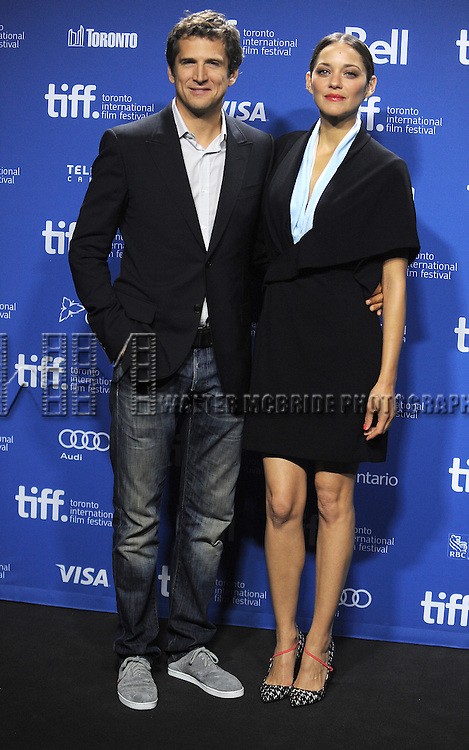 "Director Guillaume Canet and actress Marion Cotillard attending the 2013 Tiff Film Festival Photo Call for ""Blood Ties""  at the Tiff Bell Lightbox on September 10, 2013 in Toronto, Canada."