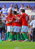 FAO SPORTS PICTURE DESK<br /> Pictured: Nathan Dyer of Swansea mobbed by team mates celebrating the third goal for Swansea. Saturday 18 August 2012<br /> Re: Barclay's Premier League, Queens Park Rangers v Swansea City FC at Loftus Road Stadium, London, UK.
