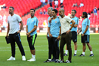 Manchester City Manager, Pep Guardiola, puts his arm around his assistant, Mikel Arteta as his team walk up the stairs to collect their medal and celebrate winning the Shield during Chelsea vs Manchester City, FA Community Shield Football at Wembley Stadium on 5th August 2018