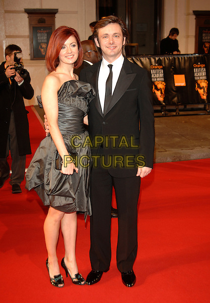 MICHAEL SHEEN & GUEST.Red Carpet Arrivals at The Orange British Academy Film Awards (BAFTA's) held at the Royal Opera House, Covent Garden, London, England, February 11th 2007..full length .CAP/PL.©Phil Loftus/Capital Pictures