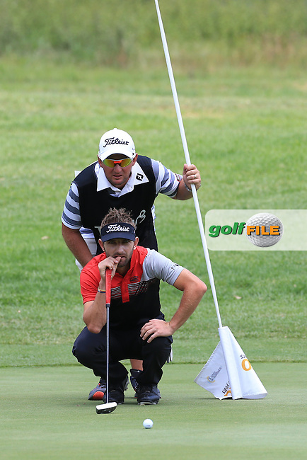 Jbe Kruger (RSA) and caddie in action on the West Course during Round 2 of the 2016 Joburg Open Celebrating 10 years, played at the Royal Johannesburg and Kensington Golf Club, Gauteng, Johannesburg, South Africa.  15/01/2016. Picture: Golffile | David Lloyd<br /> <br /> All photos usage must carry mandatory copyright credit (&copy; Golffile | David Lloyd)