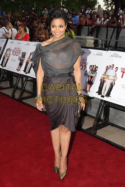 "JANET JACKSON.At a special screening of ""Why Did I Get Married Too?"" at The Ritzy cinema, Brixton, London, England, UK, .21st May 2010..full length grey gray sheer see thru through bra showing top dress draped ruched skirt gold shoes bracelets clutch bag dress .CAP/MAR.© Martin Harris/Capital Pictures."