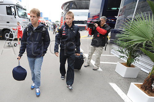 German driver Sebastian Vettel of Red Bull Racing (R) and his Finnish fitness coach Tommi Parmakoski (L) arrive at the paddock of Circuit de Catalunya race track in Barcelona, Spain, 06 May 2010. The 2010 Formula 1 Grand Prix of Spain is held on 09 May 2010.