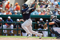 New York Yankees third baseman Miguel Andujar (41) follows through on a swing during a Grapefruit League Spring Training game against the Detroit Tigers on February 27, 2019 at Publix Field at Joker Marchant Stadium in Lakeland, Florida.  Yankees defeated the Tigers 10-4 as the game was called after the sixth inning due to rain.  (Mike Janes/Four Seam Images)