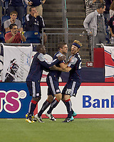 New England Revolution midfielder Chris Tierney (8) celebrates his goal with teammates. The New England Revolution defeated the Seattle Sounders FC, 3-1, at Gillette Stadium on September 4, 2010.