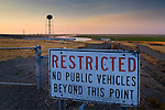 Restricted Access sign along the California Aquaduct at sunset in the Central Valley, near Los Bano, Merced County,California