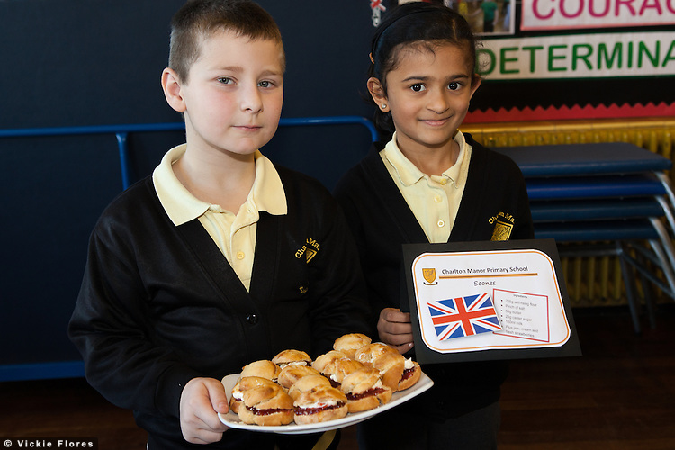 Gabriel Hunt (aged 8) and Ritika Neupane (aged 7) pose with English Scones that they made in a cookery lesson. Chef Raymond Blanc opened the new teaching kitchen at Charlton Manor Primary School in South East London on 15 February 2013 and gave a cooking demonstration to the children.