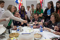 NWA Democrat-Gazette/CHARLIE KAIJO Math teacher Amy Liddell (left) serves pie to homeroom teacher Marianne Zondlak (right) as Coach Quentin Lunsford and Sheriff Shawn Holloway (from center left) taste pie during a Pi Day celebration, Thursday, March 13, 2019 at St. Vincent de Paul Catholic School in Rogers. <br /><br />Students at St. Vincent de Paul Catholic School celebrates Pi Day with a pie eating contest, games and a pi&Atilde;&plusmn;ata. Pi Day is an annual celebration of the mathematical constant &Iuml;&euro;. Pi Day is observed on March 14 since 3, 1, and 4 are the first three significant digits of &Iuml;&euro;.<br /><br />&quot;[We're] giving the kids an opportunity to get out of the classroom, do something fun and incorporate math,&quot; said Amy Liddell, seventh and eighth grade math teacher.