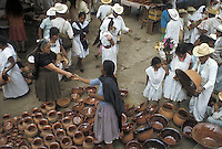 Woman selling clay pots at Sunday market in Cuetzalan, a small town in Puebla State, Mexico..