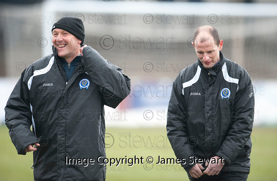 Queen of the South assistant manager Sandy Clark share a joke with manager Allan Johnston before the start of the game.