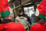 © Joel Goodman - 07973 332324 . 7 December 2013 . Batman prepares for the climb, ahead of his descent . In scenes reminiscent of a Fathers for Justice demonstration , people in superhero and Christmas-themed costumes , abseil 107 metres down the New York Street side of City Tower to raise money for the Factory Youth Zone in Harpurhey . Photo credit : Joel Goodman