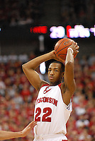 Wisconsin's Michael Flowers looks to pass, as the Badgers top Penn State 75-49 on Saturday at the Kohl Center in Madison