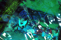 Dec. 30, 2009 - San Francisco, California, USA - While fish swim above them, visitors sit in a glass tunnel under a a 4-story rainforest at the California California Academy of Sciences Natural History Museum in San Francisco Wednesday December 30, 2009. The giant structure contains a variety of tropical life including butterflies, snakes, birds and plants. (Photo by Alan Greth)