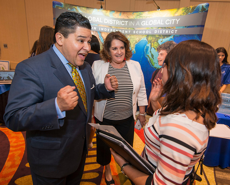 Houston ISD Superintendent Richard Carranza talks with recruits at a teacher job fair at the University of Houston, April 7, 2017.