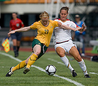 USWNT forward (8) Lauren Cheney fights for the ball with Australia's (19) Clare Polkinghorne during the Peace Queen Cup  in Suwon, South Korea.  The U.S. defeated Australia, 2-1, at the Suwon Sports Complex.