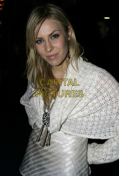NATASHA BEDDINGFIELD.Mary Poppins London premiere & press night, .Prince Edward Theatre, London, December 15th 2004..half length white cardigan jumper shawl big chunky flower necklace jewellery Bedingfield .Ref: AH.www.capitalpictures.com.sales@capitalpictures.com.©Capital Pictures.