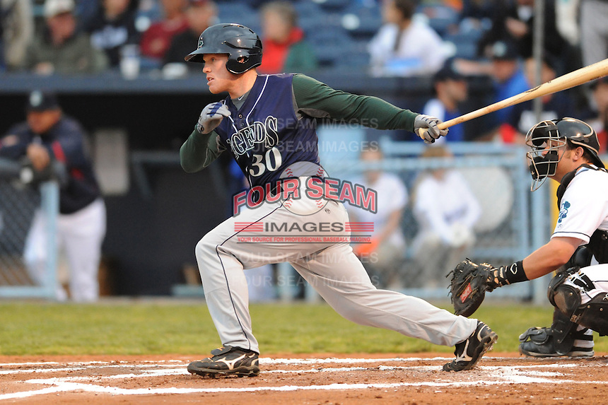 Lexington Legends Daniel Adamson Jr. #30 swings at a pitch during a game against  the Asheville Tourists at McCormick Field in Asheville,  North Carolina;  April 15, 2011.  Asheville defeated Lexington 2-1.  Photo By Tony Farlow/Four Seam Images
