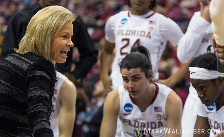 Florida State head coach Sue Semrau talks to her team in the huddle during the first half of a second-round game of the NCAA women's college basketball tournament against Missouri in Tallahassee, Fla., Sunday, March 19, 2017. (AP Photo/Mark Wallheiser)