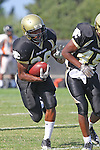 Palos Verdes, CA 09/22/11 - James Nelson (Peninsula #26), David Odusanya (Peninsula #45) and unknown Beverly Hills player(s)) in action during the Beverly Hills-Peninsula Varsitty Football gane.
