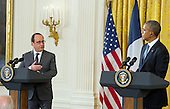 United States President Barack Obama, right, and President Francois Hollande of France, left, conduct a joint press conference in the East Room of the White House in Washington, DC on Tuesday, November 24, 2015. The leaders agreed on the need to contain ISIL.<br /> Credit: Ron Sachs / CNP