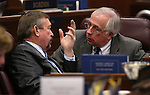 Nevada Assembly Republicans Cresent Hardy, left, and Pat Hickey work on the Assembly floor at the Legislative Building in Carson City, Nev., on Tuesday, Feb. 26, 2013..Photo by Cathleen Allison