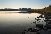Setting sun over lake Sitojaure, near Sitojaure hut, Kungsleden trail, Lapland, Sweden