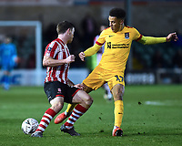 Lincoln City's Shay McCartan is fouled by Northampton Town's Shaun McWilliams<br /> <br /> Photographer Andrew Vaughan/CameraSport<br /> <br /> Emirates FA Cup First Round - Lincoln City v Northampton Town - Saturday 10th November 2018 - Sincil Bank - Lincoln<br />  <br /> World Copyright &copy; 2018 CameraSport. All rights reserved. 43 Linden Ave. Countesthorpe. Leicester. England. LE8 5PG - Tel: +44 (0) 116 277 4147 - admin@camerasport.com - www.camerasport.com