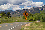 Traffic sign on rural, mountain road in Boulder, Colorado .  John leads private photo tours in Boulder and throughout Colorado. Year-round.
