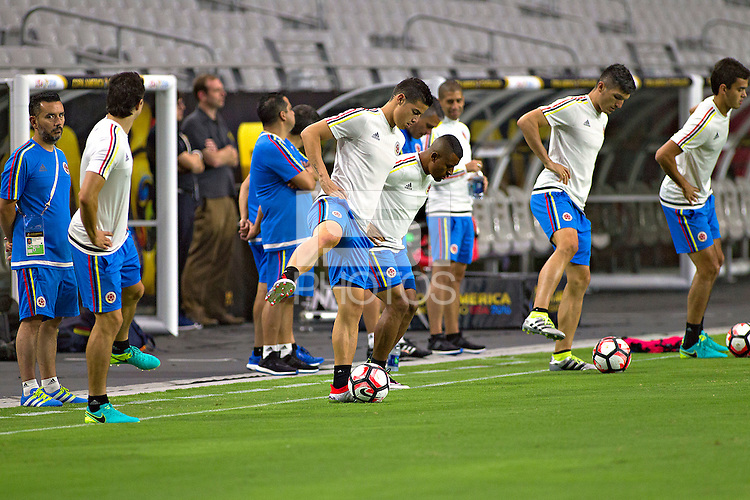 Action photo during training of the Colombia team before the game against the selection of United States for third place in the Copa America Centenario 2016 at University of Phoenix Stadium<br /> <br /> Foto de accion durante el Entrenamiento de la Seleccion de Colombia previo al partido contra la Seleccion de Estados Unidos por el tercer lugar de la Copa America Centenario 2016, en el Estadio de la Universidad de Phoenix, en la foto: John Stefan Medina, James Rodriguez y Farid Diaz<br /> <br /> <br /> 24/06/2016/MEXSPORT/Victor Posadas.