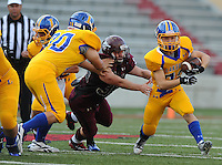 STAFF PHOTO ANDY SHUPE - Lincoln linebacker Dusty Hudson, center, is blocked by Hot Springs Lakeside offensive lineman Ethan Eye, left, as running back Ryan Viscardis carries the ball during the first half of play Monday, Sept. 1, 2014, at Razorback Stadium in Fayetteville.