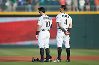 (L-R) Eddy Alvarez (10) and Juan Perez (4) stand for the National Anthem prior to the game against the Indianapolis Indians at BB&T BallPark on May 26, 2018 in Charlotte, North Carolina. The Indians defeated the Knights 6-2.  (Brian Westerholt/Four Seam Images)