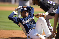 March 13, 2010 - Milwaukee Brewers' Alcides Escobar (#21) is thrown out while trying to leg out a triple during a spring training game against the Colorado Rockies at Maryvale Baseball Park in Maryvale, Arizona.