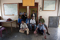A group of coffee farmers gather at a community centre in the mountain town of Laclubar, Timor-Leste on Wednesday, Oct. 19th, 2011.  Photographer: Daniel J. Groshong/The Hummingfish Foundation