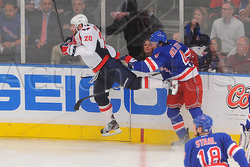 07.05.2012. New York, NY, USA.  New York Rangers defenseman Michael Del Zotto (4) checks Washington Capitals left wing Troy Brouwer (20) during third period action in game 5 of the NHL Eastern Conference Semi-finals between the Washington Capitals and New York Rangers at Madison Square Garden in New York, N.Y.