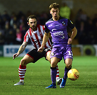 Port Vale's Luke Hannant shields the ball from  Lincoln City's Neal Eardley<br /> <br /> Photographer Andrew Vaughan/CameraSport<br /> <br /> The EFL Sky Bet League Two - Lincoln City v Port Vale - Tuesday 1st January 2019 - Sincil Bank - Lincoln<br /> <br /> World Copyright &copy; 2019 CameraSport. All rights reserved. 43 Linden Ave. Countesthorpe. Leicester. England. LE8 5PG - Tel: +44 (0) 116 277 4147 - admin@camerasport.com - www.camerasport.com